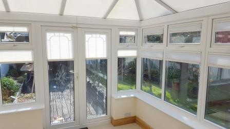 conservatory windows fitted with pleated blinds