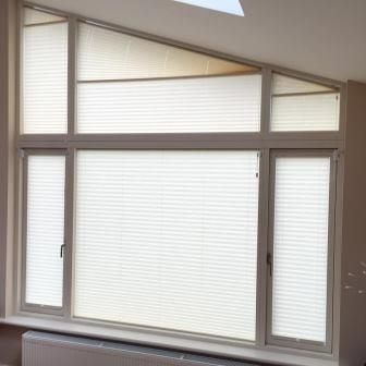 shaped  blinds on window