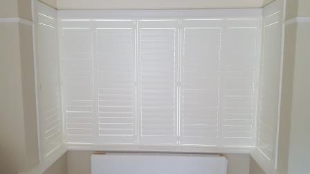 bay window shutters in milltown louvres closed