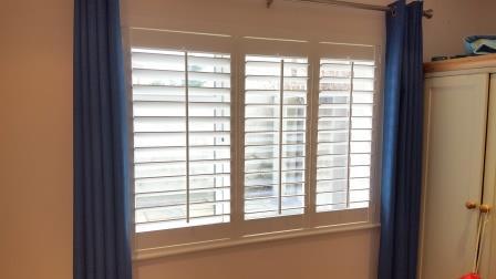 plantation shutters with centered tilt rods, dublin 16