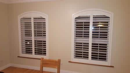 2 arched shutters