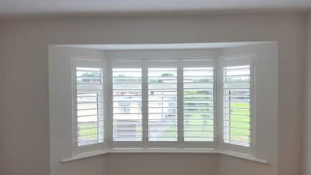 Silk white coloured plantation shutters were fitted in for 12 window shutters