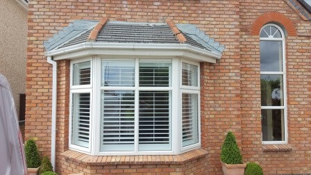 Bay window plantation shutters fitted in dundalk for Exterior window shutter repair
