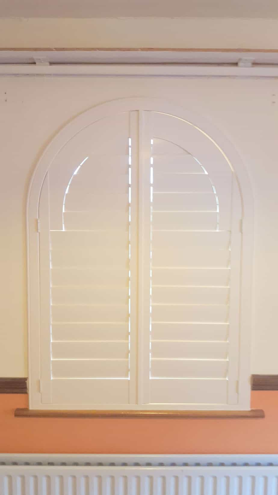 Shutters Are The Ideal Solution For Arched And Bay Windows
