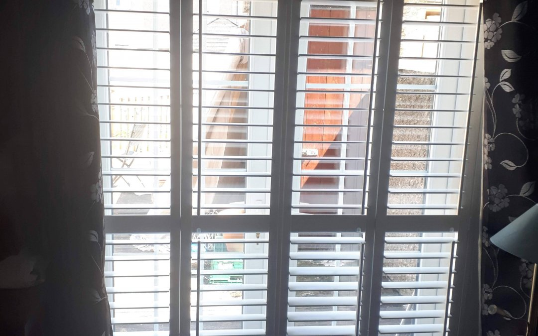 Plantation Shutters fitted onto patio doors and a kitchen window.