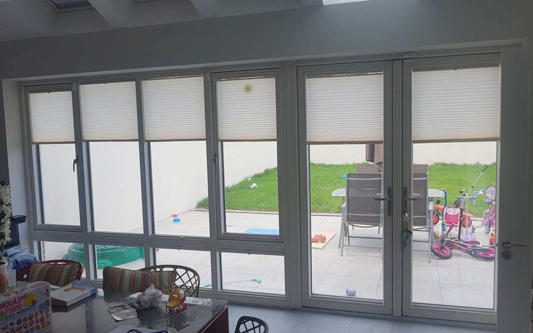 Pleated blinds and a roller blind installed in Castleknock Cross, Castleknock, Dublin 15