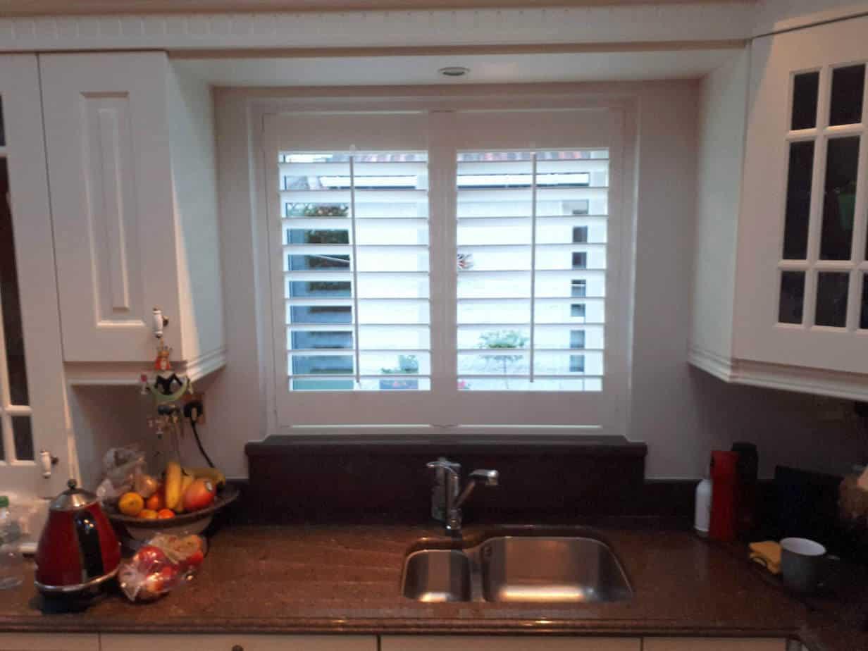 Plantation shutter installed on a kitchen window ...
