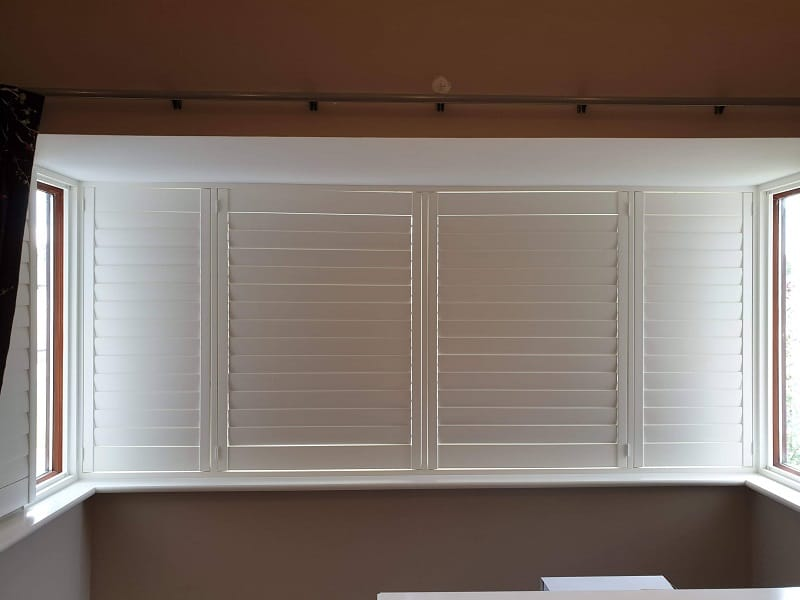 Large Bay window fitted with White Plantation Shutter in Straffan Kildare