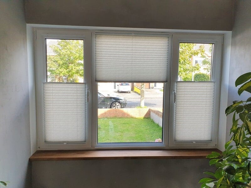 Pleated and Duette blinds installed on Tilt and Turn windows.