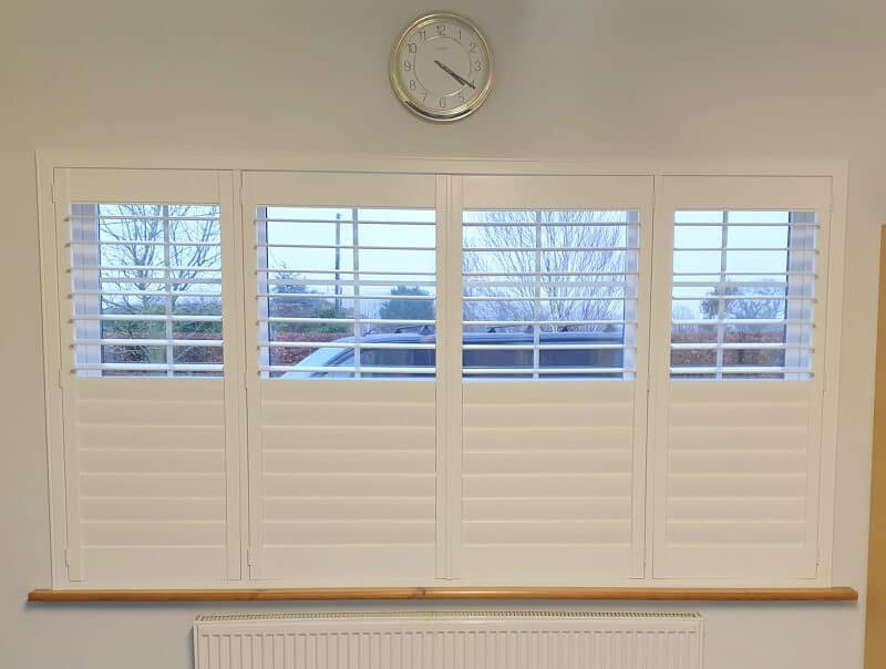 White Plantation Shutters installed in a Large Conservatory.