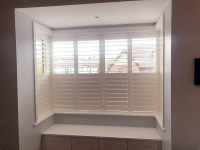 2 Large Bay Windows fitted with Weston and Titan Shutters.